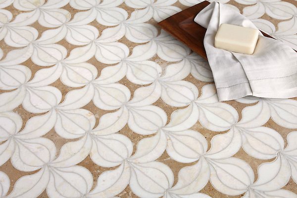 Calla, a handmade mosaic shown in honed Lavigne and polished Cloud Nine, is part of the Miraflores Collection by Paul Schatz for New Ravenna.<br /> <br /> For pricing samples and design help, click here: http://www.newravenna.com/showrooms/