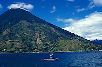 Maya man poling a boat on Lake Atitlan, Guatemala