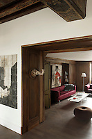 In this snug next to the small salon a contemporary painting by Jean-Gilles Badaire hangs against a backdrop of the original antique panelling of the apartment