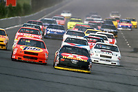 Davey Allison leads at the start of a 1992 NASCAR race at Pocono Raceway near Long Pond, Pennsylvania.