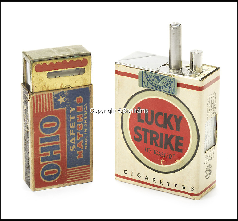 BNPS.co.uk (01202 558833)Pic: Bonhams/BNPS<br /> <br /> The Lucky Strike Spy Camera, 1949-1950. Estimate &pound;27,000-&pound;43,000.<br /> <br /> An incredible archive of rare vintage spy cameras that would rival James Bond's own collection has emerged for sale for a staggering &pound;400,000.<br /> <br /> The Heath Robinson-style cameras date from the 1880s and come in numerous wacky guises including a book, a wristwatch, a packet of cigarettes, binoculars and even a handgun.<br /> <br /> Many of the ingenious devices were commercial failures and so very few were made, making surviving examples worth tens of thousands of pounds now.<br /> <br /> The collection will be sold at London auctioneers Bonhams on December 3.