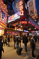A Famous Dave's BBQ restaurant and a Dave and Buster's restaurant share a space in Times Square in New York, seen on Wednesday, November 23, 2011. (© Richard B. Levine)