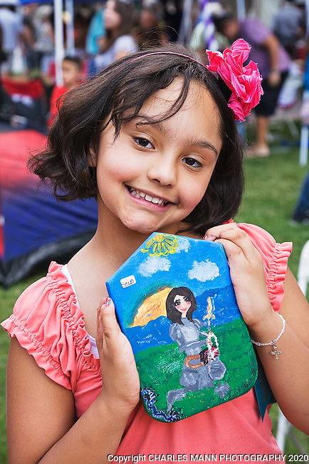 The Santa Fe Spanish Market, held in late July, fills the Santa Fe Plaza with artists, patrons and visitors all celebrating the richness of the Spanish Colonial art tradition side by side with the Contemporary Spanish Art Market.  Youth Artist Simona Rael show off her favoirte retablo for 2011.