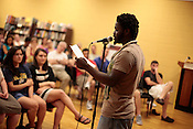 Sacrificial Poets presented a community wide poetry open mic at Flyleaf Books in Chapel Hill, N.C., Wednesday, July 6, 2011. CJ Suitt, Executive Director of the Sacrificial Poets, present some new work to the open mic crowd.