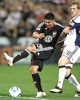 Jaime Moreno #99 of D.C. United is pulled back by Pat Phelan #28 of the New England Revolution during an MLS match on April 3 2010, at RFK Stadium in Washington D.C.