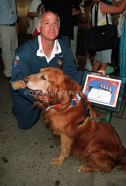 "Capt. Scott Shields (Emergency Management Director for Marine Safety Service) pictured with his pooch Bear. ....Bear, who is 12-year-old golden retriever, is one of the top Ground Zero search-and-rescue dogs and The Guinness Book of Records' ""the most celebrated dog in the world."" Bear worked tirelessly for months at the World Trade Center site suffering cuts, bruises and smoke inhalation, which led to his worsened health conditon. Bear has been treated for skin cancer, prostatitis, nerve damage, arthritis, which resulted in $3000 in veterinary bills. Although, Bear and all other WTC search-and-rescue dogs, have had free policies from Veterinary Pet Insurance of Anaheim, Calif., the insurer refuses to cover the dog's medical bills insisting that Bear does not meet the requirements. The insurer insists that it had the perfect right to deny coverage, saying Bear's woes were ""pre-existing conditions"" and ""old age disabilities."" Scott Shields, however, says that Bear had never been sick a day in his life until the 9/11 tragedy. July 2002. Please byline: Alecsey Boldeskul/NY Photo Press.   ..*PAY-PER-USE*      ....NY Photo Press:  ..phone (646) 267-6913;   ..e-mail: info@nyphotopress.com"