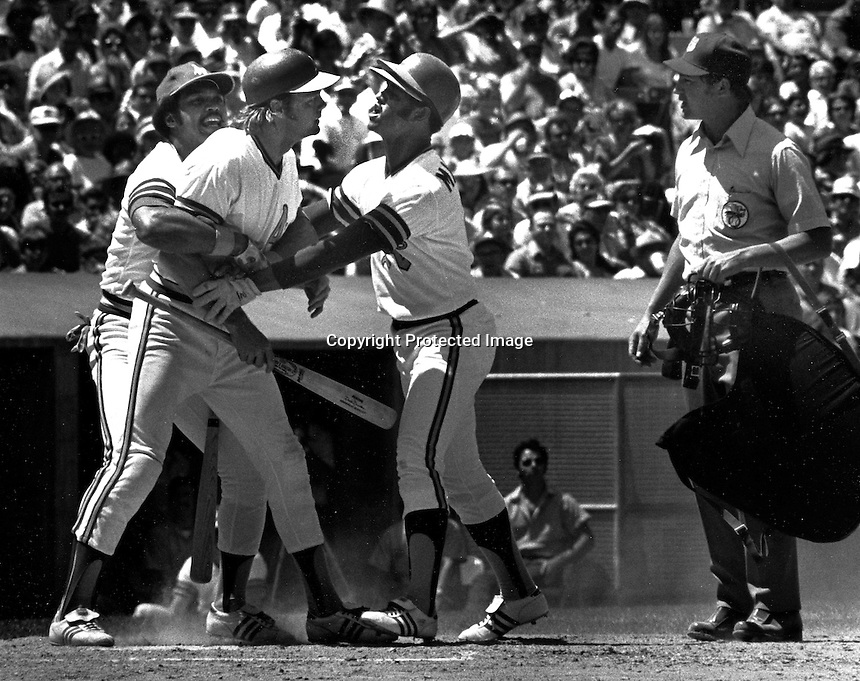 A's catcher Dave Duncan is restrained by Reggie Jackson and Angel Manguel. (1972 photo by Ron Riesterer)