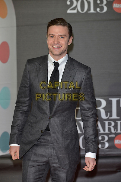 Justin Timberlake.The Brit Awards 2013 arrivals at the O2, Greenwich, London, England 20th February 2013.The Brits half length grey gray suit  black tie white shirt .CAP/PL.©Phil Loftus/Capital Pictures.
