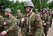 The last draft. Young Polish soldiers on the way back from the range.Bartoszyce, Poland, May 2008<br /> (Photo by Piotr Malecki / Napo Images)<br /> Ostatni pobor.Powrot z zajec na poligonie. Bartoszyce.5/2008<br /> Fot: Piotr Malecki / Napo Images