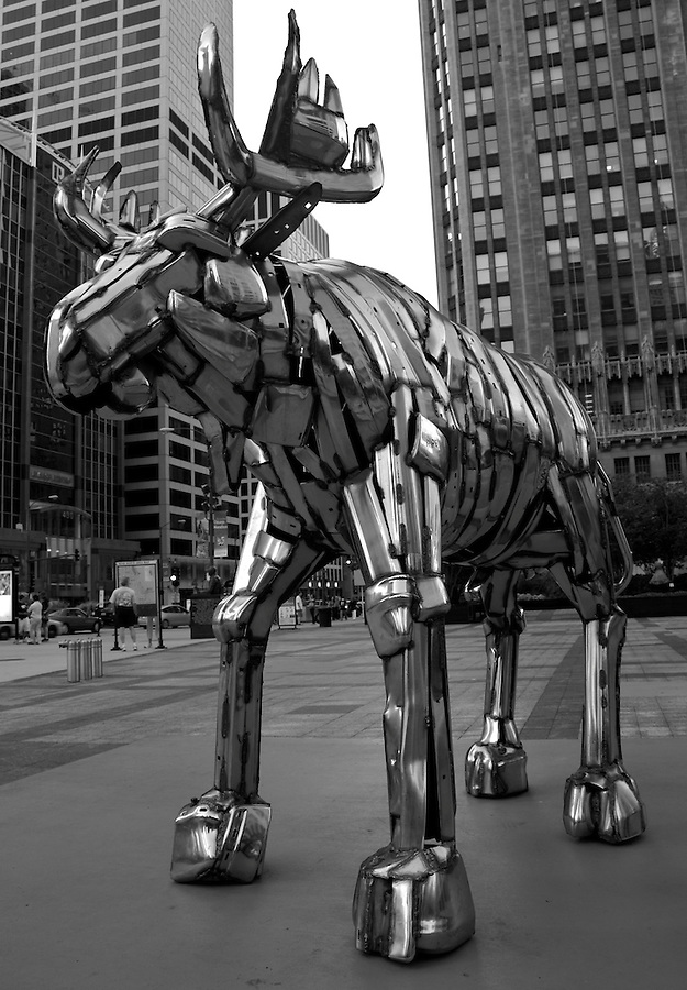Traveling exhibit of Bernar Venet sculpture plaza near Tribune Tower coil of iron metal moose in Chicago.