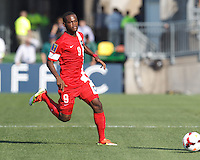 Cuban midfielder Jose Ciprian (9) dribbles. In CONCACAF Gold Cup Group Stage, the national team of Cuba (white) defeated national team of Belize (red), 4-0, at Rentschler Field, East Hartford, CT on July 16, 2013.