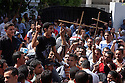 Egyptian Coptic Christians demonstrate and chant pro-Christian slogans as they mourn for victims of sectarian violence October 10, 20011 outside the Coptic Hospital in Cairo, Egypt. At least 26 people, mostly Christian, were killed during sectarian clashes that saw the worst violence since the Revolution that toppled former Egyptian president Hosni Mubarak earlier this year. Egyptian Coptic Christians make up about 10% of Egypt's 80 million population and periodically violence flares between the Christian minority and the majority Muslim population. (Photo by Scott Nelson)