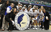 The Duke team recieves the Championship trophy. This was the Championship game of the 2011 ACC Tournament in Greensboro on March 6, 2011. Duke beat UNC 81-66. (Photo by Al Drago)
