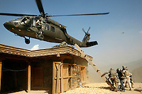 An American Black Hawk helicopter comes in to land on the roof of a house to take out Captain Dan Kearney following a meeting with villagers to discuss insurgent activity..Battle Company, 2nd Battalion Airborne of the 503rd US Infantry are undergoing a 15 month deployment in the Korengal Valley, epicentre of the war and scene of fierce fighting with the Taliban...