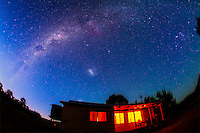 The southern Milky Way near dawn, December 2012, over Timor Cottage, Coonabarabran, NSW, Australia. This is a stack of 3 x 2 1/2 minute exposures, tracked, with the Canon 5D MkII at ISO 800 and 15mm lens at f/2.8. The ground is from one exposure to avoid blurring of foreground details. Dawn twlight is tinting the sky blue. Orion is at right, Sirius high in the upper right, Vela and Puppis at top centre, and Carina, the Carina Nebula, and the Southern Cross at upper left.