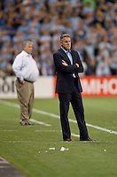 Sporting Kansas City head coach Peter Vermes watches his team along with Seattle Sounders head coach Sigi Schmid during the game at Livestrong Sporting Park in Kansas City, Kansas.   Sporting Kansas City won the Lamar Hunt U.S. Open Cup on penalty kicks after tying the Seattle Sounders in overtime.