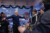 Concord, New Hampshire.USA.January 26, 2004..General Wesley Clark campaigns on the final day before the vote. Here he demonstrates military jumping jacks for 4 teen boys in return of a vote.