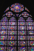 Stained glass window inside the Notre Dame Cathedral, Paris, France.