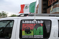 "Phoenix, Arizona - A vehicle that is part of the ""Caravan for Peace with Justice and Dignity"" displays images of Zapatista Army of National Liberation member Francisco Sántiz López and Professor Alberto Patisthán Gómez --both political prisoners-- is parked on Central Avenue in Downtown Phoenix, next to the Civic Space Park, where a really was held on August 15, 2012. The sign demands to free both men. Supporters assure the men were accused of crimes they never committed. The ""Caravan for Peace with Justice and Dignity"" stopped in Phoenix on Wednesday, August 15, 2012 as it travels across the United States as a way to create awareness in the United States about the failed drug war in Mexico that has left more than 70,000 dead. The caravan is led by Mexican poet, essayist, novelist, and journalist Javier Sicilia, whose son Juan Francisco Sicilia Ortega son was brutally murdered along with six other students in Morelos, Mexico by members of a drug cartel on March 28, 2011. In response, Sicilia created the Movement for Peace with Justice and Dignity --popularly known as ¡Ya Estamos Hasta la Madre! or We Have Had It!-- calling for an end the drug cartels bloodshed. Photo by Eduardo Barraza  © 2012"