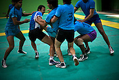 The defendant team nabs a raider during the kabbadi training sessions as part of the training at a month long camp for the Indian national Kabbadi team in Sport Authority of India Sports Complex in Bisankhedi, outskirts of Bhopal, Madhya Pradesh, India.