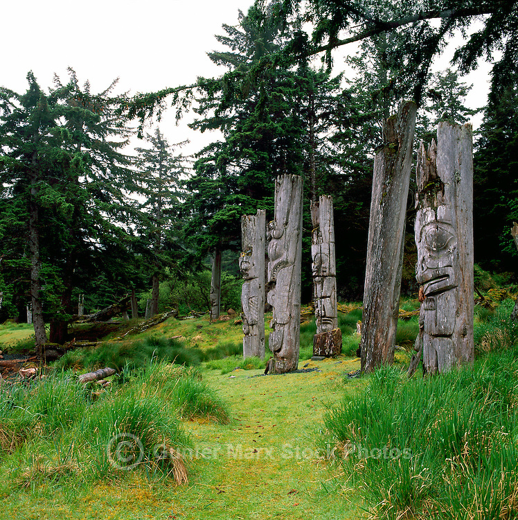 Historic Haida Mortuary Totem Poles at Ninstints (UNESCO World Heritage Site) on Anthony Island (Skung Gwaii), Gwaii Haanas National Park Reserve and Haida Heritage Site, Queen Charlotte Islands (Haida Gwaii), Northern BC, British Columbia, Canada