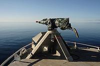 Covered harpoon gun on bow of Norwegian whaling boat Barents sea Arctic Norway North Atlantic.