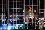 Downtown Kansas City at night reflecting in the glass of the US Bank Building