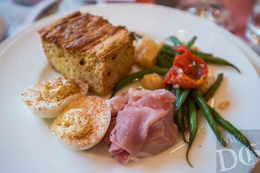 NWA Democrat-Gazette/ANTHONY REYES &bull; @NWATONYR<br /> The picnic plate, deviled eggs, country ham, marinated vegetables and corn bread at a crawfish boil Wednesday, April 15, 2015 at The Hive, inside the 21C hotel in Bentonville. Many boils happen this time of year. The Hive's boil featured a four course meal with crawfish flown in fresh from the gulf coast. Chef Matt McClure created each dish.