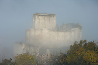 LES ANDELEYS, FRANCE - OCTOBER 10: View of the remains of the outer wall, the embossed ramparts and the keep of the Chateau Gaillard in a fog, on October 10, 2008 in Les Andelys, Normandy, France. The chateau was built by Richard the Lionheart in 1196, came under French control in 1204 following a siege in 1203. It was later destroyed by Henry IV in 1603 and classified as Monuments Historiques in 1852. (Photo by Manuel Cohen)