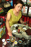 Making Tea at a Beijing Teahouse - The Chinese drink tea all day long for good health and simple pleasure.   According to popular legend, tea was discovered by Chinese Emperor Shennong when a leaf from a Camellia  tree fell into water the emperor was boiling. Tea is deeply woven into the history and culture of China and is considered one of the seven necessities of life along with firewood, rice, oil, salt, soy sauce and vinegar.