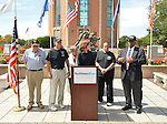 East Meadow, New York, U.S. - September 3, 2014 - KATHLEEN RICE, at podium, Democratic congressional candidate (NY-04), releases a whitepaper on veterans policy and announces formation of her campaign's Veterans Advisory Committee, at Veterans Memorial at Eisenhower Park, after touring Northport VA Medical Center with outgoing Rep. CAROLYN MCCARTHY (in white jacket). Congresswoman McCarthy and 4 committee members joined Rice at the press conference: speaking is JEREMIAH E. BRYANT (in black suit), of Rockville Centre, U.S. Army, Vietnam War Veteran; STEVE BONOM, (in black T-shirt and pants) of Massapequa, U.S. Navy, Vietnam War Veteran; PAT YNGSTROM, (in black T-shirt and cap) of Merrick, U.S. Army Paratrooper, Vietnam War Veteran; and PAUL ZYDOR, (in blue shirt) of Merrick, U.S. Navy, Korean War Veteran. Rice is in her third term as Nassau County District Attorney, Long Island.