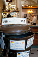 Caffe Gambrinus in Naples, offering 'caffè sospeso' or suspended coffee - container where patrons put in their scontrino or receipt for a free coffee for someone in need.