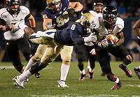 PITTSBURGH, PA - NOVEMBER 05: Alex Chisum #80 of the Cincinnati Bearcats attempts to run through a tackle by Todd Thomas #8 of the Pittsburgh Panthers on November 5, 2011 at Heinz Field in Pittsburgh, Pennsylvania.  (Photo by Jared Wickerham/Getty Images)