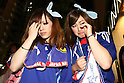 June 19, 2010 - Tokyo, Japan - Japanese fans react as they watch the public viewing of the 2010 World Cup football match Netherlands vs Japan at Shibuya district in Tokyo, Japan, on June 19, 2010. The Netherlands defeated Japan 1-0.