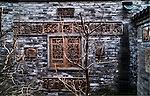 Bare trees stand in the courtyard of a ancient Chinese residence called a Hutong.