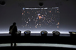 A man looks at an interactive display inside the space section at the metropolitan science museum in Nagoya, Aichi Prefecture, Japan on 13 Oct. 2011. Photograph: Robert Gilhooly