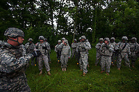 """Members of the Georgia Army National Guard's 48th Brigade, 148th Brigade Support Battalion, undergo an """"after-action review"""" following an attack and medical evacuation scenario during a media visit day at Camp Atterbury, Indiana on Wednesday, June 3, 2009. The review allows a discussion of how the unit reacted correctly or incorrectly in dealing with the surprise firefight. The brigade's upcoming overseas mission is to train the Afghan National Army and Police forces."""