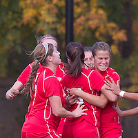 Marist College midfielder Kathryn Hannis (2) celebrates her goal with teammates.  Boston College defeated Marist College, 6-1, in NCAA tournament play at Newton Campus Field, November 13, 2011.