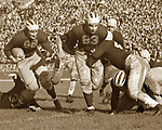Kromer Leads Tom Harmon Around End vs Illinois, 1938