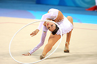 August 23, 2008; Beijing, China; Rhythmic gymnast Anna Bessonova of Ukraine reaches for hoop on way to winning bronze in the Individual All-Around final at 2008 Beijing Olympics..Photo note: Version 2 with closer cropping.