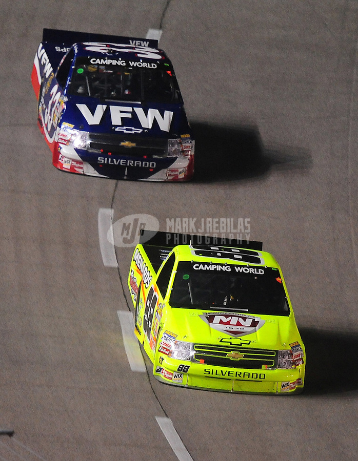 Nov. 6, 2009; Fort Worth, TX, USA; NASCAR Camping World Truck Series driver Matt Crafton leads Ron Hornaday during the WinStar World Casino 350 at the Texas Motor Speedway. Mandatory Credit: Mark J. Rebilas-