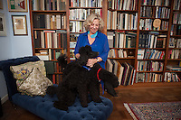 New York, NY - October 03, 2013 : Author Erica Jong with her 10-month-old poodles Simone (blue collar) and Collette (red collar), at her apartment in New York, NY on October 03, 2013. Fear of Flying, celebrating its 40th anniversary, is a 1973 novel by Erica Jong, which became famously controversial for its attitudes towards female sexuality, and figured in the development of second-wave feminism.
