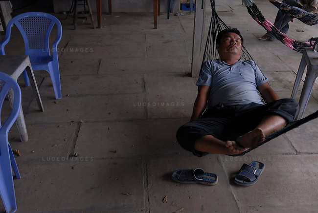 A Vietnamese man takes a nap outside of Ho Chi Minh City, Vietnam.