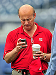 24 April 2010: Washington Nationals' President Stan Kasten checks a message prior to a game against the Los Angeles Dodgers at Nationals Park in Washington, DC. The Dodgers edged out the Nationals 4-3 in a thirteen inning game. Mandatory Credit: Ed Wolfstein Photo