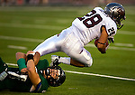 Sacramento State's, Ryan McMahon, #6 tackles Univ. of Montana's, Peter Nguyen, #28 as Sacramento State University hosts the University of Montana football team, Saturday Sept 24, 2011..Brian Baer/Special to the Bee