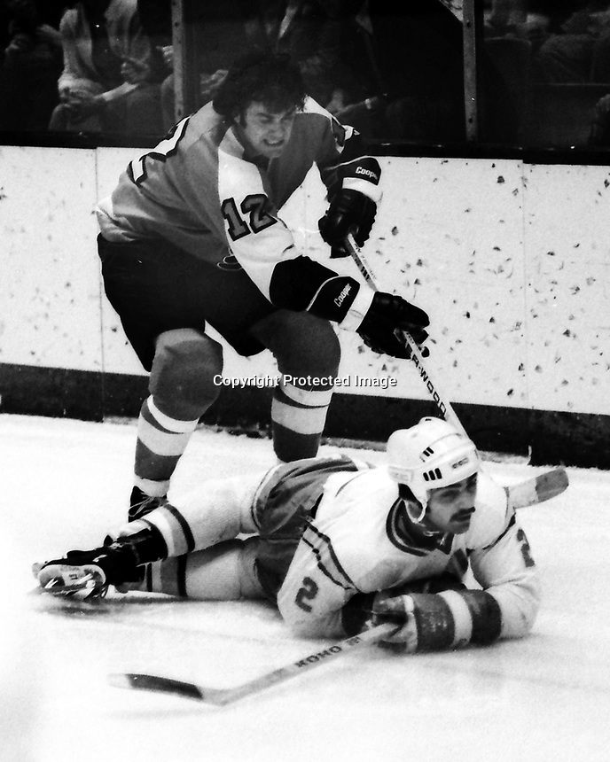 Seals vs Flyers: Flyers Gary Dornhoeferover Seals Rick Hampton. (1975 photo/Ron Riesterer)