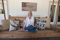 NWA Democrat-Gazette/J.T. WAMPLER Jenny Marrs sits on her rope swing on her back porch Thursday May 12, 2016.