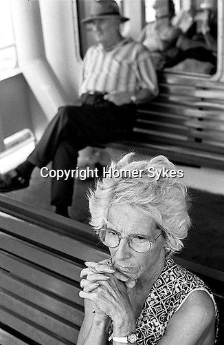 Woman on ferry journey home across Sydney harbour.  Australia.