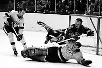 California Golden Seals vs Los Angeles Kings ,<br />Seals Norm Ferguson flys over Kings goalie Gerry Desjardins or Denis DeJordy, #6 Dale Rolfe. (1969 photo by Ron Riesterer)