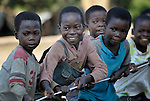 Children play tug of war in the Makpandu refugee camp in Southern Sudan, 44 km north of Yambio, where more that 4,000 people took refuge in late 2008 when the Lord's Resistance Army attacked their communities inside the Democratic Republic of the Congo. Attacks by the LRA inside Southern Sudan and in the neighboring DRC and Central African Republic have displaced tens of thousands of people, and many worry the attacks will increase as the government in Khartoum uses the LRA to destabilize Southern Sudan, where people are scheduled to vote on independence in January 2011. Catholic pastoral workers have accompanied the people of this camp from the beginning.